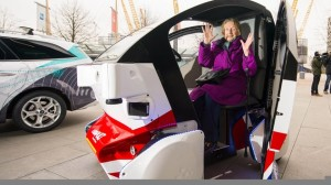 Brenda Stevenson, 82, from Greenwich, sits inside a prototype of the Pathfinder driverless pod that will be the first autonomous vehicle in the UK to work on public footpaths