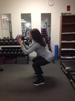Medicine Ball Squat and Arm Curl End Position First Commercial Break